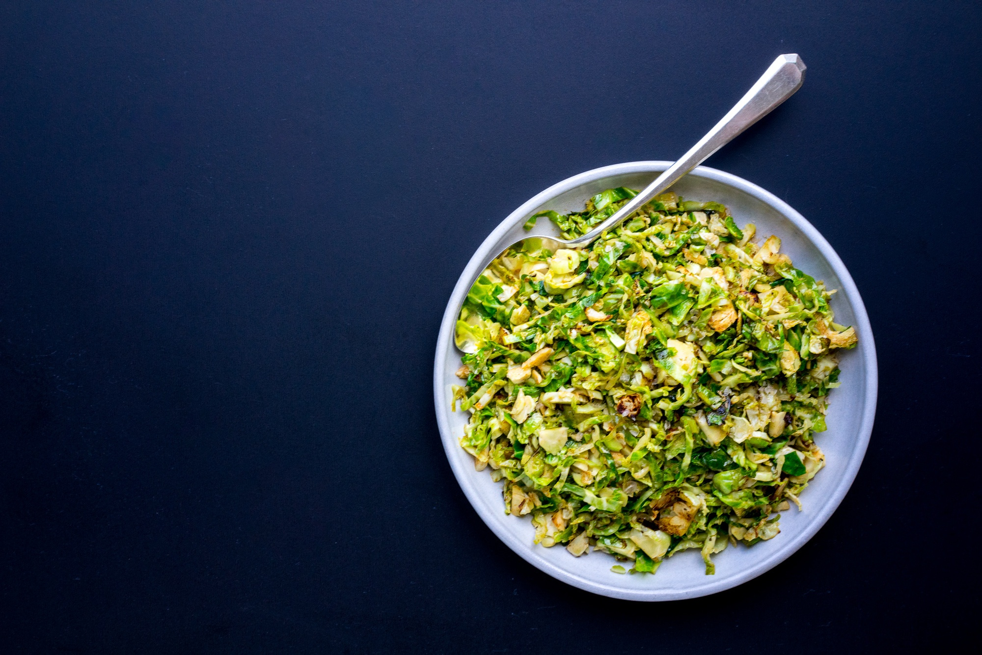 Warm Brussels Sprouts Slaw with Bacon & Juniper Berries